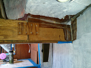 Photo: light cloth tabbing added to woodwork above entrance to quaterberth