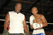 Themba Zulu with one of his boxing  charges,  Mxolisi Nombewu. Zulu died on Thursday/ SUPPLIED