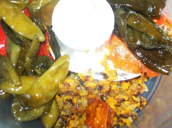 Let the peppers cool slightly and in a food processor put the cooked peppers,...
