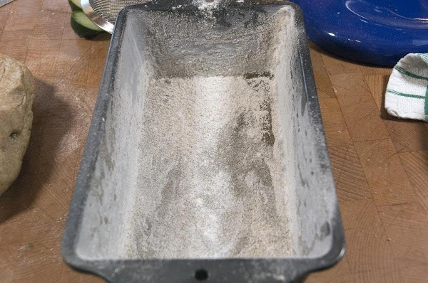 While the dough is rising, take a baking pan, and lightly oil and then...