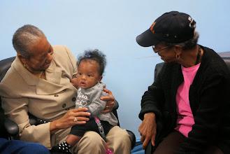 Photo: Ola holds Manuela's great grandchild