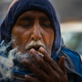 Morning Mist by Avanish Dureha - People Portraits of Men ( iamdpc, smoke, chandni chowk, portrait, delhi )