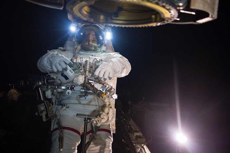 Suited up for his spacewalk, astronaut Randy Bresnik is wearing his Extravehicular Mobility Unit. File photo.