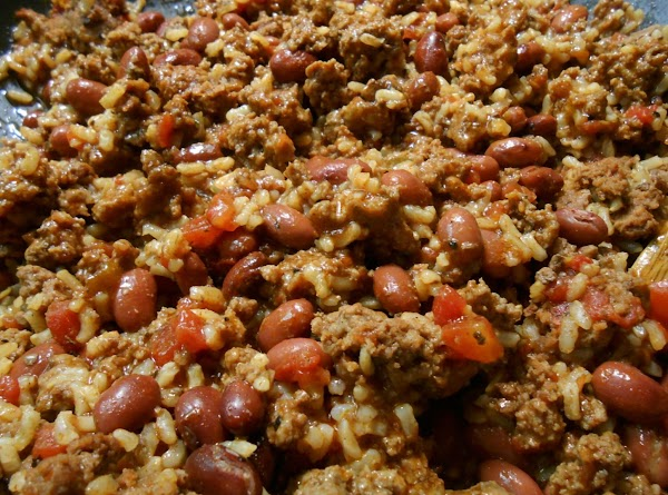 Once rice is tender add beans.  Make sure you drain and rinse beans...