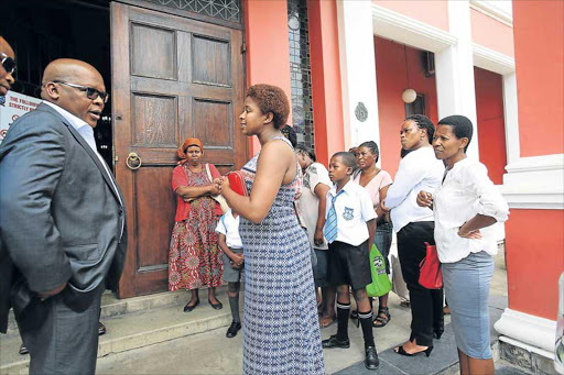LEARNING DIFFICULTY: Dozens of parents from around Buffalo City Metro whose children have not been admitted to schools into school visited executive mayor Xola Pakati, left, yesterday to ask for his intervention Picture: SINO MAJANGAZA