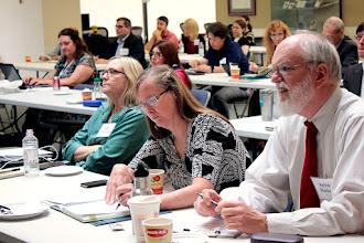 Photo: Kris Gremillion, Ohio State University; Rosiland James, USDA-ARS; and Kevin Hackett, USDA, listen to Megan Davis' talk on aquaculture.