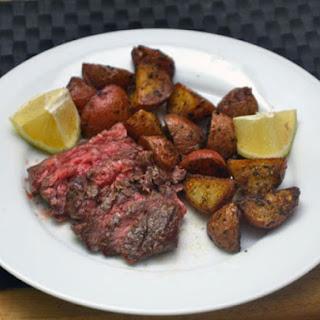 Skirt Steak with Roasted Potatoes and Lemon.
