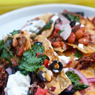 Beef Barbacoa Nachos with Pickled Red Onions.