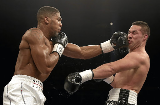 Anthony Joshua on his way to taking Joseph Parker's WBO belt at Principality Stadium in Cardiff, where he drew sellout crowds. His next two fights will be at Wembley Stadium.