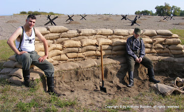 Photo: Digging foxholes and filling sandbags – top Tim Jones, Chester, Ill., Tim Schulte, St. Paul, Mo.