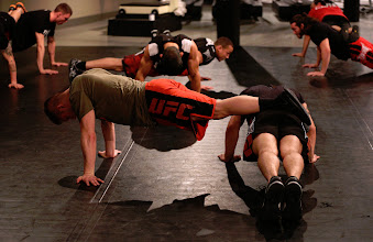 Photo: Justin Lawrence and Sam Sicilia do pushups with a twist