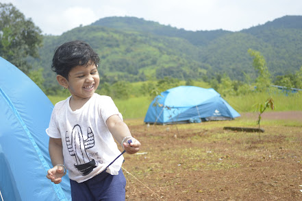 This smile is priceless - Kids love camping