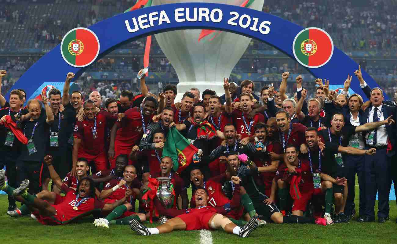 Alt: The Portuguese soccer team celebrates winning the Euro 2016 competition - Photo by Lars Baron/Getty Images
