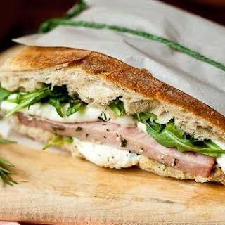 Grilled Ham Sandwich with Mozzarella and Arugula.