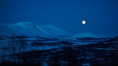 Photo: Full moon over  the winter landscape at Hjerkinn, in Dovre mountains, Norway