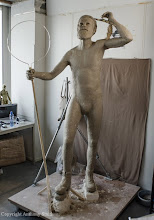 Photo: Fleshing-out the body form with a surface layer of water-based sculpting clay, which is similar to common potters clay, but with no grit or 'grog', which gives it a nice smooth finish.