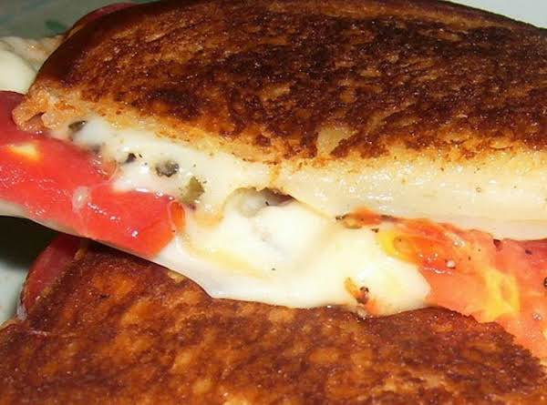 Here Is My Version Made With Mozzarella, Provolone, Tomatoes And Basil.