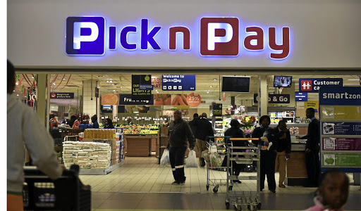 Pick n Pay employee Mduduzi Mnisi organises stock on the shelves on August 18 2020 after the government banned the sale of cigarettes. Sales in core food and groceries at Pick n Pay SA grew by 10%, while liquor and tobacco sales fell 31%.