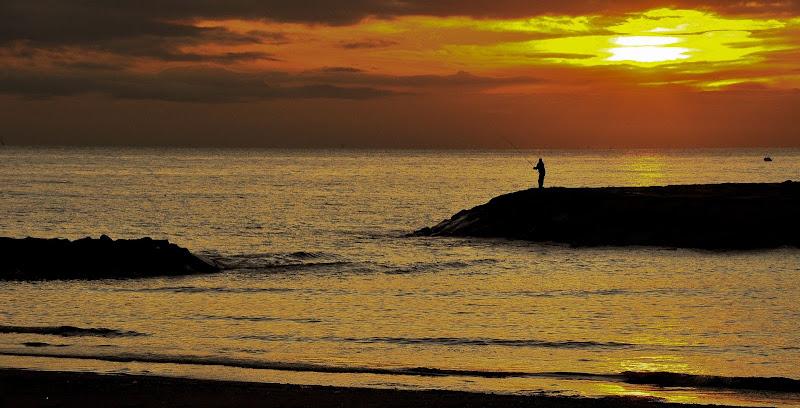 pesca al tramonto di enzocala