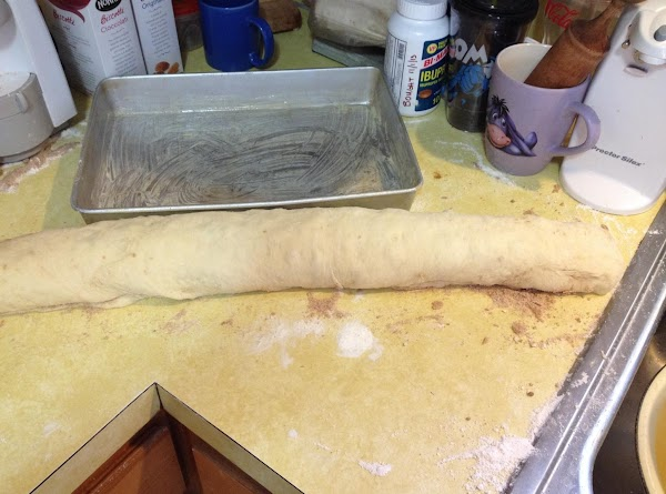 "With a sharp knife, cut the roll of dough into 2"" sections.  *You..."