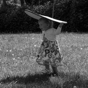 Reflector Play by Scott Morgan - Black & White Street & Candid ( little girl, park, grass, dress, play, little, reflector, photography )