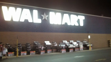 Photo: So, I picked up my mom one late muggy evening and we took a trip to our local Wal Mart to purchase a solution to my craft-lighting issue. That is one bright Wal Mart sign! It draws me in. Maybe I can take the sign home and that will give me enough sewing light! Ha ha!