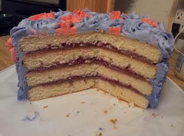 White Almond Cake w/ Raspberry Filling