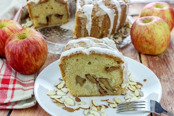 A Slice Of Jewish Apple Cake On A Plate.