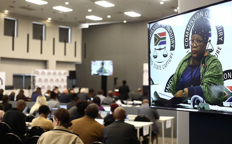 Former ANC MP Vytjie Mentor can be seen on a TV screen during her third day of testifying at the state capture inquiry in Parktown, Johannesburg on August 29 2018.