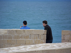 Photo: A couple of roommates hanging out looking at the sea.