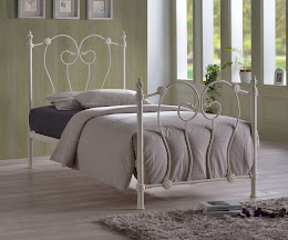 Victorian Style Metal Bedstead in a bedroom
