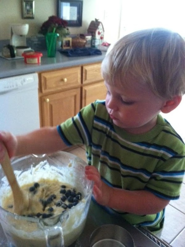 He's only two but he does a great job stirring muffins.