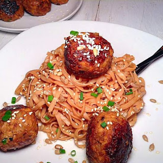 Sweet Tofu And Chickpea Balls On Rice Noodles With Peanut Butter Sauce.