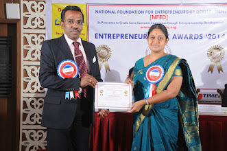 Photo: Prof. Dr. R. Ganesan, Chairman, NFED Issuing Certificate of Appreciation To Prof. S. Lakshmipriya, Programme Convener, Entrepreneurs' Day Awards '2014
