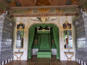 Photo: Tall blue and white porcelain stoves flank each side of the duke's bedroom.