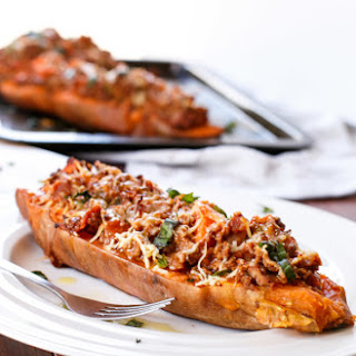 Cheesy Bacon Bolognese Stuffed Sweet Potatoes.