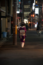 Photo: *Geisha in a hurry*  I had been in Geian for almost two hours. I'd pretty much given up hope, when this vision floated past, hurrying with some burden.   Nothing seemed to stop her: everyone just stood aside and bowed.  What could I have done?