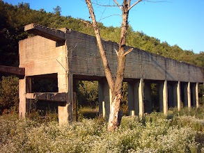 Photo: Some industrial facility framework on the shore of the previous quarry lake
