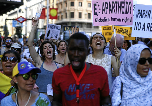 People march during a protest — as an early commemoration of World Refugee Day on June 20 — in Madrid, Spain, on June 17 2017. Picture: REUTERS