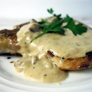 Pork Chops with Andouille Sausage Cream Gravy.