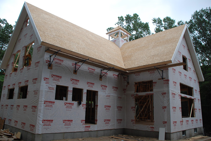Photo: Roof sheathing goes on