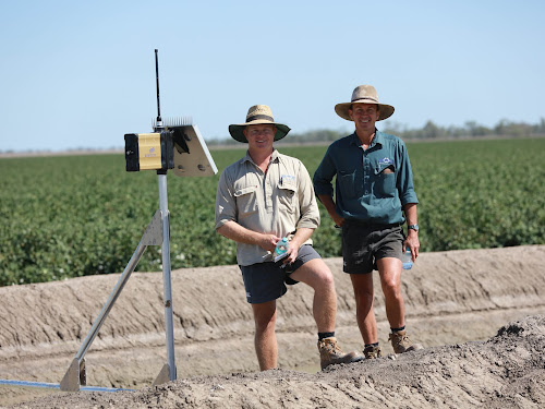 Steve Carolan and farm manager Andrew Greste with some of the automated irrigation infrastructure at 'Waverley', near Wee Waa, the site of a promising technology trial that could benefit all of Narrabri Shire in a range of different ways. Photo: Melanie Jenson