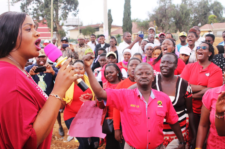 Laikipia county Woman Representative Catherine waruguru addressing her supporters at Thingithu grounds yesterday after she was chased away from AIPCA Nanyuki church.