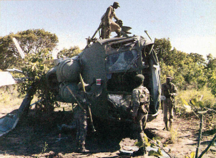 Troops clamber over an Angolan Air Force, Russianbuilt Mi-8 assault helicopter shot down during the battles. This helicopter is codenamed Hip by NATO.