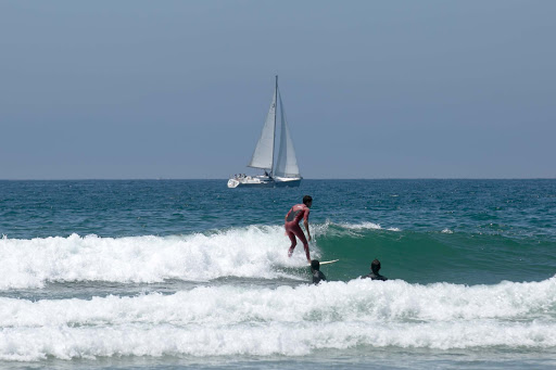 Surfer-with-sailboat.jpg - A surfer and sailboat in the waters of Venice Beach, California.