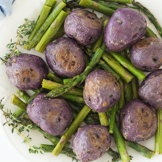 Garlic Roasted Potatoes with Thyme and Asparagus.