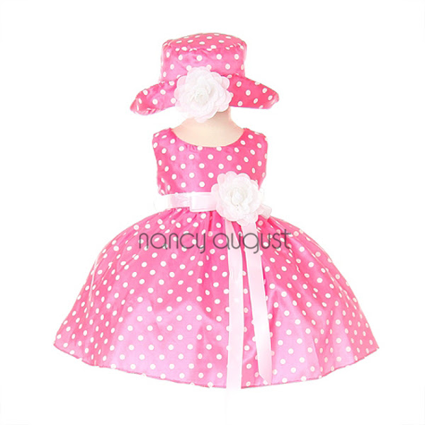 Photo: Popping Pink Polka-Dot Baby Flower Girl Dress: Dress up your precious baby girl in this cute popping polka-dot baby flower girl dress! A fun addition to her wardrobe, this dress features a detachable floral accent for a completely adorable look. The bodice and skirt are both accented with popping polka dots for an extra-fun look and feel. This playful number also features a white bow sash that perfectly complements the white polka dot pattern. Your precious baby will look darling in this exciting dress! Layers of crinoline add the perfect bouncy effect to the skirt, leaving you and your baby with a big smile! Pair the dress with white tights and our ballerina flats for a fun and delightful appeal. Dress also available in toddler and girl sizes.Dress colors available in Turquoise, Brown, and Pink.