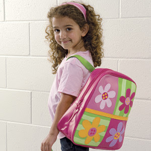 Little girl wearing floral backpack