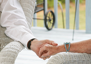 Image of Senior Couple Holding Hand to Show Dementia Care Givers