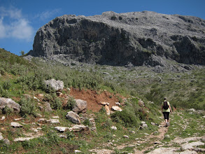 Photo: Fast forward: rounding the big conical hill and approaching the big bare mountain, called Amola.